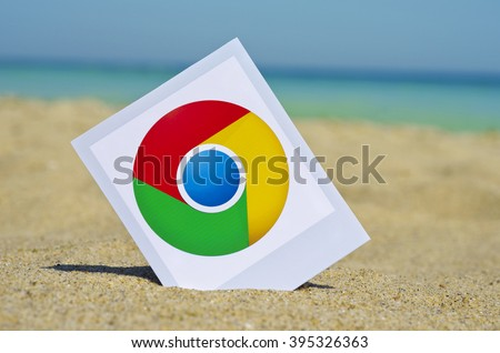 Kiev, Ukraine - August10, 2015:  Google Chrome ogotype printed on paper and placed in the sand against the sea.  Google Chrome is a freeware web browser.