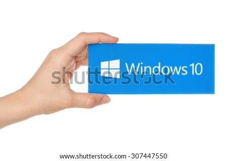 KIEV, UKRAINE - AUGUST 18, 2015:Hand holds Windows 10 logotype printed on paper. Windows 10 is an operating system developed by Microsoft. - stock photo