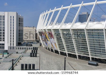 KIEV, UKRAINE - AUGUST 07: Olympic National Sports Complex hosted the final of Euro 2012 championship with banners portraits of Dynamo Kiev footbal team key players on August 07, 2013 in Kiev, Ukraine - stock photo