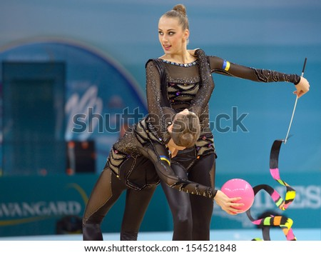 KIEV, UKRAINE - AUGUST 31: Team Ukraine performs the routing with balls and ribbons during the 32nd Rhythmic Gymnastics World Championships in Kiev, Ukraine on August 31, 2013 - stock photo
