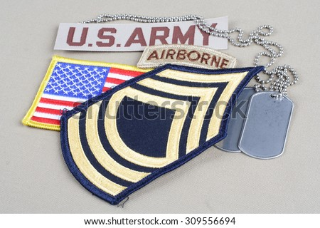 KIEV, UKRAINE - August 21, 2015.  US ARMY Master Sergeant rank patch, airborne tab, flag patch and dog tag