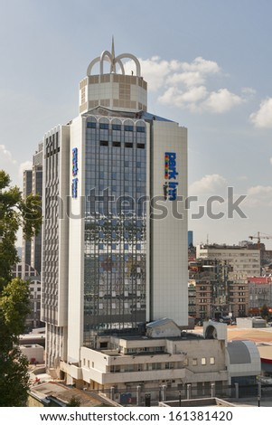 KIEV, UKRAINE - AUGUST 07: Workers are working on the roof of Hotel Park Inn by Radisson on Trinity Square on August 07, 2013 in Kiev, Ukraine. The Hotel is located in front of Olympic Stadium arena.