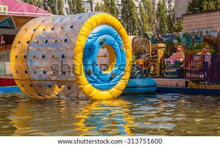 KIEV, UKRAINE - AUGUST 30: Zorbing air bubbles on water. Amusement park in August 2015 in Kiev, Ukraine