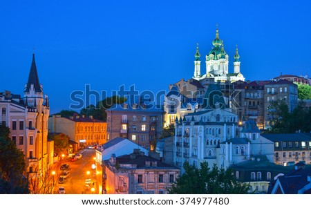 Kiev, Ukraine. Beautiful night view of the ancient street Andrew's Descent and the St. Andrew's Church from the Castle Hill in Kyiv - stock photo