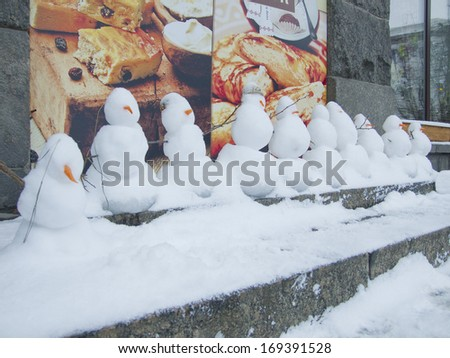 KIEV, UKRAINE � CIRCA DECEMBER 2012: Snowmans as decoration of storefront in the food shop on December 2012 in Kiev, Ukraine.