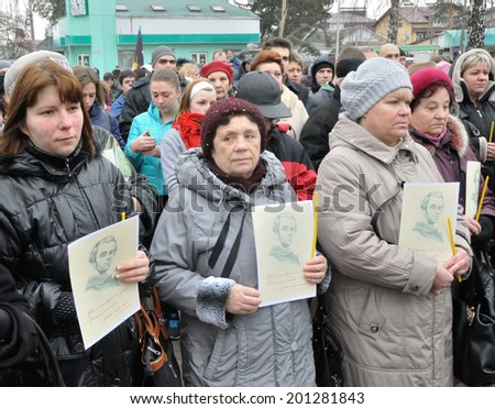 KIEV, UKRAINE - CIRCA FEBRUARY 2014: Unknown people pray on a requiem mass by died people during Ukrainian revolution on February 2014 in Kiev, Ukraine.