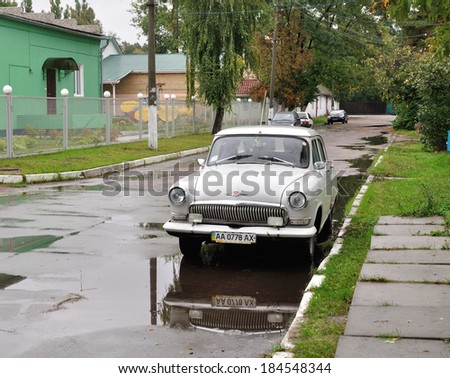 "KIEV, UKRAINE - CIRCA MARCH 2013: The soviet car ""VAZ"" parking in industrial district circa March 2013 in Kiev, Ukraine - stock photo"