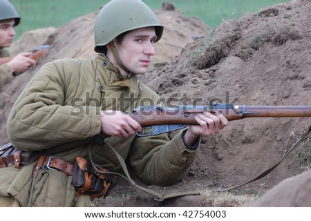 KIEV, UKRAINE - DEC 6: Member of a history club wears historical Soviet uniforms during a WWII reenactment 'Defense Kiev' in 1943 December 6, 2009 in Kiev, Ukraine