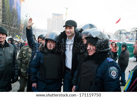KIEV, UKRAINE - DEC 10: Popular ukrainian opposition politician Vitali Klitschko photographed with a detachment of policemen during anti-government protest Euromaidan on December 10, 2013 in Kyiv  - stock photo
