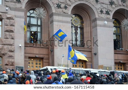 KIEV, UKRAINE - DECEMBER 11 2013: Buses of the riot police conquer the city hall occupied by protesters in KYIV, UKRAINE - DECEMBER 11 2013.