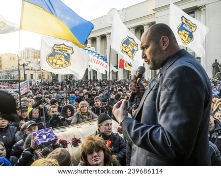 KIEV, UKRAINE - December 23, 2014: Deputy Borislav Bereza tries to calm protesters -- To break through the cordon of police and four special forces in full uniform - stock photo