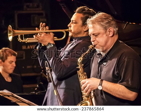 KIEV, UKRAINE - December 13, 2014: Dmitry Shlelyayn - alto saxophone, Dennis Adu - trumpet, flugelhorn; Pavlo Litvinenko - piano Constantine Ionenko Quintet performs on International festival Jazz Bez - stock photo