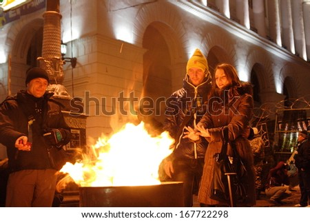 KIEV, UKRAINE-DECEMBER 5, 2013:Independence Square in Kiev, Ukraine. Protesters are heated by the fire.