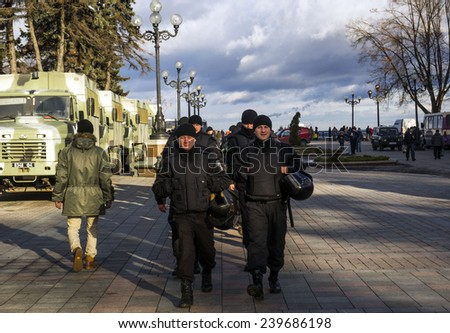 KIEV, UKRAINE - December 23, 2014: National Guard of Ukraine comes the protection of the Verkhovna Rada. -- To break through the cordon of police and four special forces in full uniform - stock photo