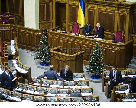KIEV, UKRAINE - December 23, 2014: Near the rostrum Verkhovna Rada installed Christmas trees. -- To break through the cordon of police and four special forces in full uniform - stock photo