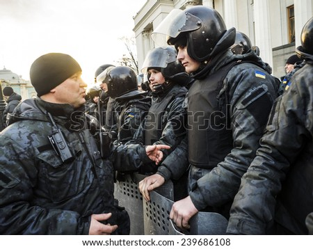 KIEV, UKRAINE - December 23, 2014: The commander of the National Guard sends soldiers to dinner. -- To break through the cordon of police and four special forces in full uniform - stock photo