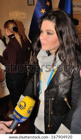 KIEV, UKRAINE � 15 DECEMBER 2013: The Ukrainian singer and winner of the Eurovision Song Contest Ruslana Lyzhychko talks with unknown journalists on a briefing on December 15, 2013 in Kiev, Ukraine