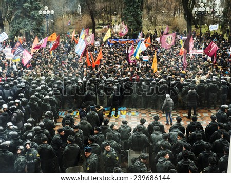 KIEV, UKRAINE - December 23, 2014: Thousands of protesters gathered near the Verkhovna Rada. -- To break through the cordon of police and four special forces in full uniform, in Monday - stock photo