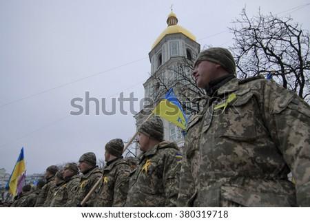 KIEV, UKRAINE - Feb 21, 2016: In Kiev held a march in honor of the defenders of the bridgehead Debaltsevskogo - stock photo