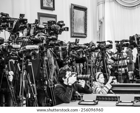 KIEV, UKRAINE - Feb 25, 2015: Photographer press service of the Cabinet of Ministers of Ukraine Andrew Kravchenko (in front) photographs the during a meeting of the Cabinet.