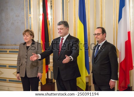 KIEV, UKRAINE - Feb 5, 2015: President of Ukraine Petro Poroshenko during an official meeting with French President Francois Hollande and Chancellor of the Federal Republic of Germany Angela Merkel - stock photo
