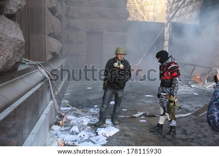 KIEV, UKRAINE - FEB 18, 2014: Protesters are waiting for water coming to extinguish the fire near city hall.