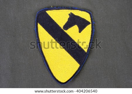 KIEV, UKRAINE - Feb 01, 2015. US ARMY 1st Cavalry Division patch on olive green uniform