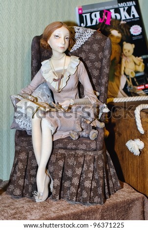 KIEV, UKRAINE - FEBRUARY 26: A collectible doll, which resembles a young lady in armchair, is on display at the Fashion Doll International exhibit on February 26, 2012 in Kiev, Ukraine.