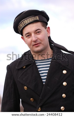 KIEV, UKRAINE - FEBRUARY 2, 2008. A member of the military history  club, wears a military Russian Civil War sailor uniform circa 1918 in Kiev, Ukraine on February 2, 2008.