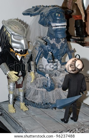 KIEV, UKRAINE - FEBRUARY 26: A set, which resemble a marriage of Alien and Predator, is on display at the Fashion Doll International exhibit on February 26, 2012 in Kiev, Ukraine.