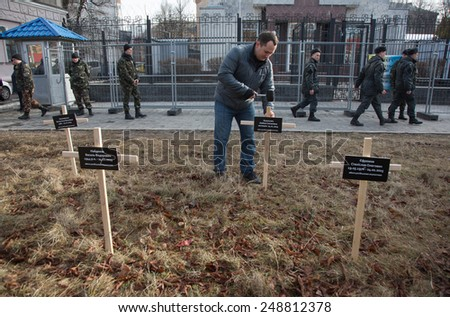 KIEV, UKRAINE - FEBRUARY, 1, 2015: Activists put crosses with the names of people who died on January 24 during the shelling of Mariupol (Ukraine East), near the Embassy of Russia in Ukraine - stock photo