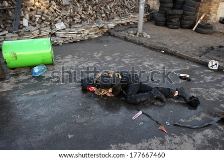 KIEV, UKRAINE - FEBRUARY 18, 2014: Affected by the actions of the police lying unconscious on the floor. Kiev, Ukraine, Kiev, 18.02.2014 - stock photo