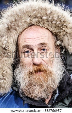 KIEV, UKRAINE - FEBRUARY 24, 2016: Bearded photographer during UEFA Champions League football match FC Dynamo Kiev (Ukraine) vs FC Manchester City (England) at NSC Olimpiyskyi stadium in Kyiv