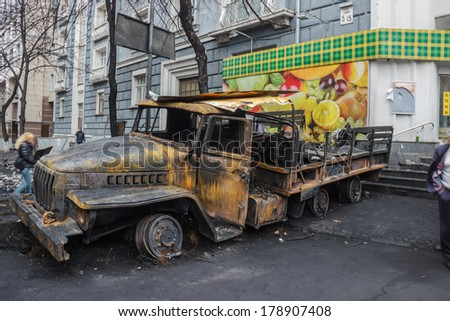 Kiev, Ukraine - February 22, 2014: Burnt truck in the city center after the cessation of military actions.