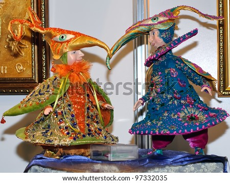 KIEV, UKRAINE - FEBRUARY 26: Collectible dolls, which resemble two boys in strange hats, are on display at the Fashion Doll International exhibit on February 26, 2012 in Kiev, Ukraine.