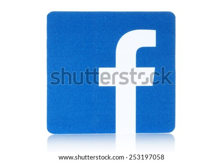 KIEV, UKRAINE - FEBRUARY 16, 2015: Facebook logo sign printed on paper and placed on white background. Facebook is a well-known social networking service. - stock photo