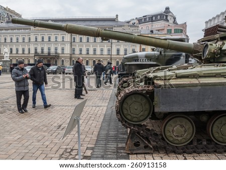 """KIEV, UKRAINE - FEBRUARY 21: 20-28 February in Kiev, St. Michael's Square, an exhibition of """"Presence"""". It presents samples of military equipment and ammunition used by Russian troops in the Donbas. - stock photo"""
