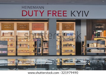 KIEV, UKRAINE - FEBRUARY 08, 2015: Heinemann Duty Free shop display in Kyiv Boryspil International Airport. Duty free shops are retail outlets that are exempt from the payment of certain taxes. - stock photo