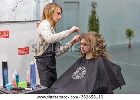 KIEV, UKRAINE - FEBRUARY 04, 2016: Londa hairdresser works at Kyiv Fashion 2016 show in KyivExpoPlaza exhibition center. It was the 30th edition of popular Kyiv Fashion International Vogue Festival.  - stock photo