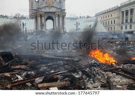 KIEV, UKRAINE - February 19, 2014: Mass anti-government protests in the center of Kiev. Destroyed barricades on Independence Square after a night of fights