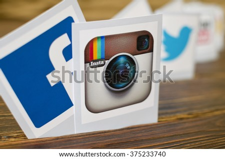 Kiev, Ukraine - February 09, 2015: Set of most popular social media icons: Facebook, Instagram,Twitter,Youtube  printed on paper on the wooden table - stock photo