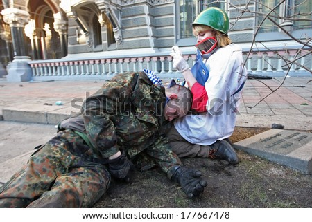 KIEV, UKRAINE - FEBRUARY 18, 2014: The doctor provides medical care to an unconscious person. Kiev, Ukraine, Kiev, 18.02.2014