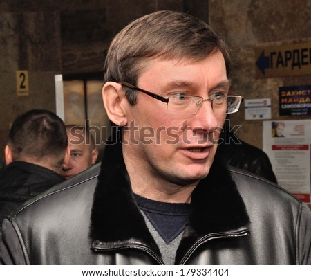 KIEV, UKRAINE � 16 FEBRUARY 2013: The Ukrainian political prisoner and ex-minister Yurij Lutsenko speaks with unknown journalists in government building on February 16, 2013 in Kiev, Ukraine. - stock photo