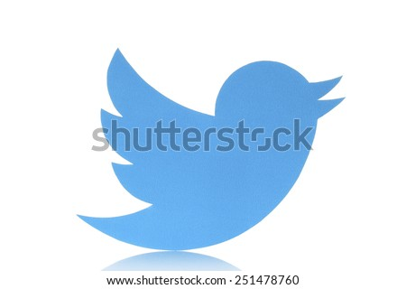 KIEV, UKRAINE - FEBRUARY 05, 2015:Twitter logotype bird printed on paper. Twitter is an online social networking service that enables users to send and read short messages. - stock photo