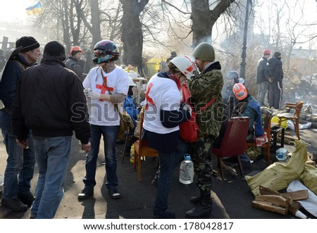 KIEV, UKRAINE - February 21, 2014: Ukrainian revolution, Euromaidan. Medical volunteers helps soldiers