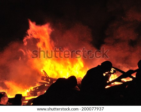 KIEV, UKRAINE - 19 FEBRUARY 2014: Unknown demonstrators burn tires and fight with police in government district on February 19, 2014 in Kiev, Ukraine.