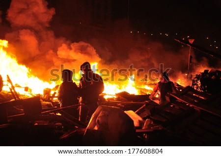 KIEV, UKRAINE � 18 FEBRUARY 2013: Unknown demonstrators fight with police on a barricade on Ukrainian revolution on February 18, 2013 in Kiev, Ukraine. - stock photo