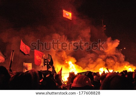KIEV, UKRAINE � 18 FEBRUARY 2013: Unknown demonstrators fight with police on a barricade on Ukrainian revolution on February 18, 2013 in Kiev, Ukraine. - stock photo