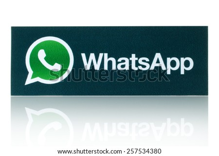 KIEV, UKRAINE - FEBRUARY 19, 2015:WhatsApp Messenger logotype printed on paper. WhatsApp Messenger is an instant messaging app for smartphones. - stock photo