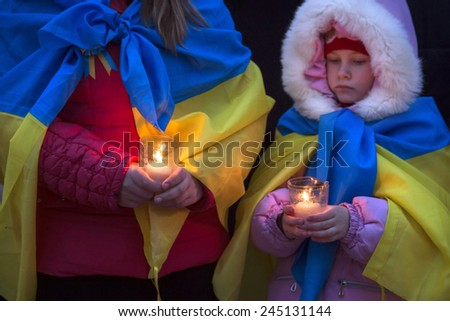 """KIEV, UKRAINE - Jan 18, 2015: Banners """"I Volnovaha"""" and candles on Independence Square during the march of solidarity against terrorism and memory of victims of terrorist attack in Volnovakha - stock photo"""